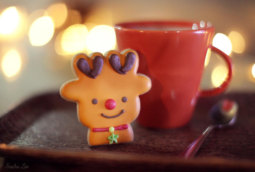 a cute and delicious reindeer cookie at christmas time with a mug of hot tea, cookies and tea coffee