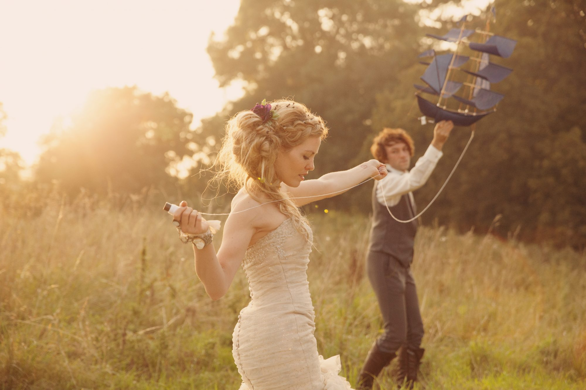 A gorgeous and dreamy romantic looking couple at their wedding at Crabwall manor having a photoshoot in the sunset with a Peter Pan pirate kite