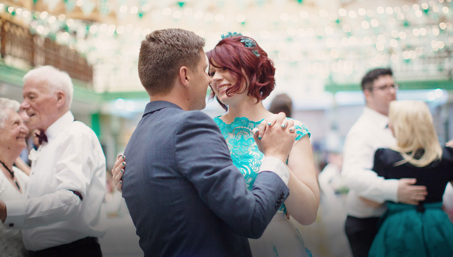 A beautiful couple with a turquoise wedding dress dancing at their wedding at Manchester Victoria Baths