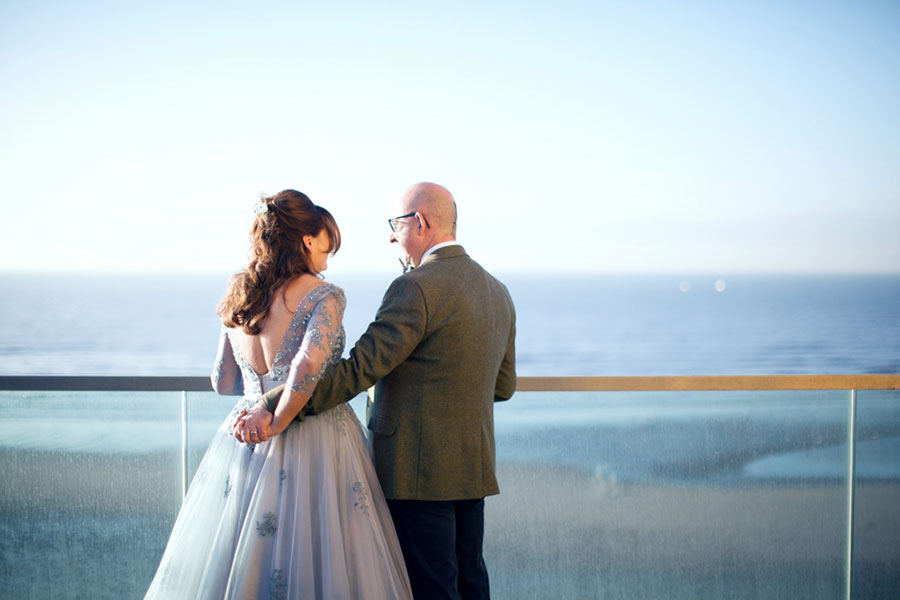A wedding by the seaside at Blackpool Festival House - A beautiful blue / lilac bridal dress by Fairy Gothmother with natural wedding photography