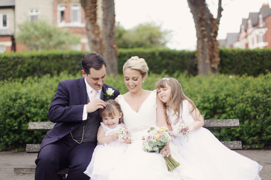 A beautiful family wedding photoshoot with two daughters at Ashton Park in West Kirby with natural wedding photography of family photoshoot ideas by Sasha Lee Photography