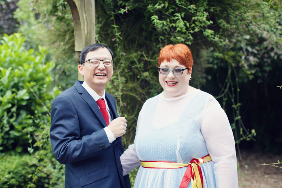 A pretty Double Tree Hilton Sheffield wedding with a white English bride and Asian Chinese groom. Pixar Up themed wedding