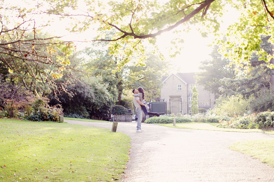 A gorgeous Autumn Fall engagement couple photoshoot in the Sheffield Botanical Wedding with beautiful Autumnal red leaves and warm colouring