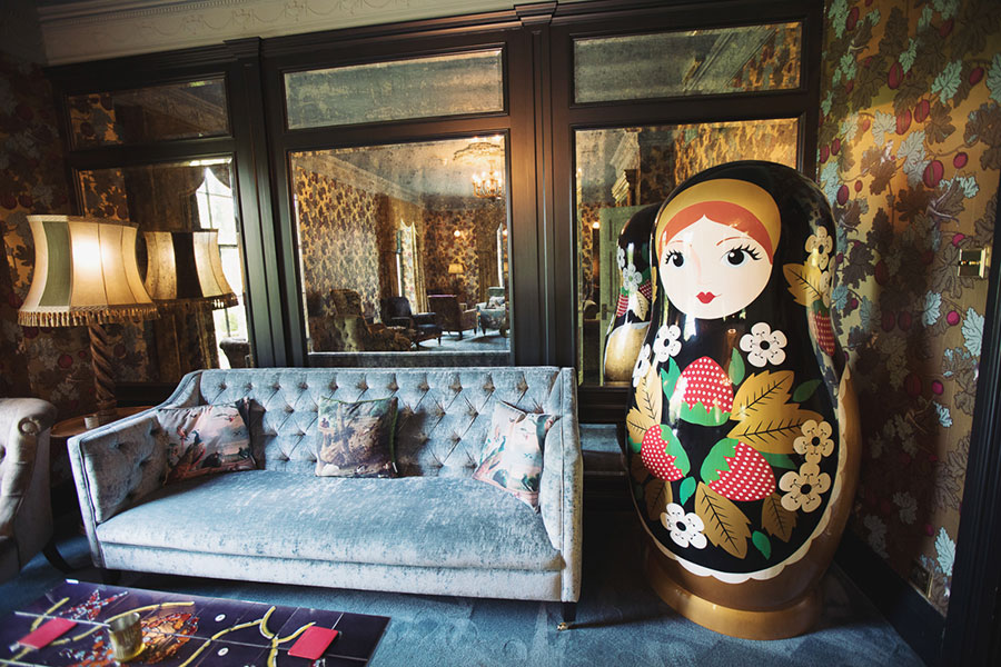 A crazy cool alternative and unique Thirsk York Yorkshire wedding venue The Crab & Lobster with natural wedding photography with a photo of a room with a giant Russian doll