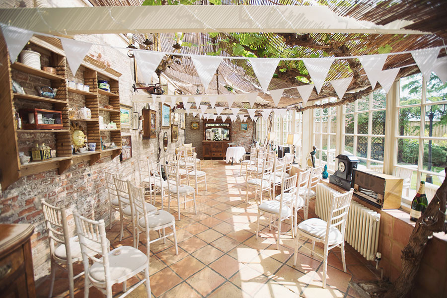 A crazy cool alternative and unique Thirsk York Yorkshire wedding venue The Crab & Lobster with natural wedding photography with a photo of a conservatory ceremony | Small & Intimate wedding venue UK