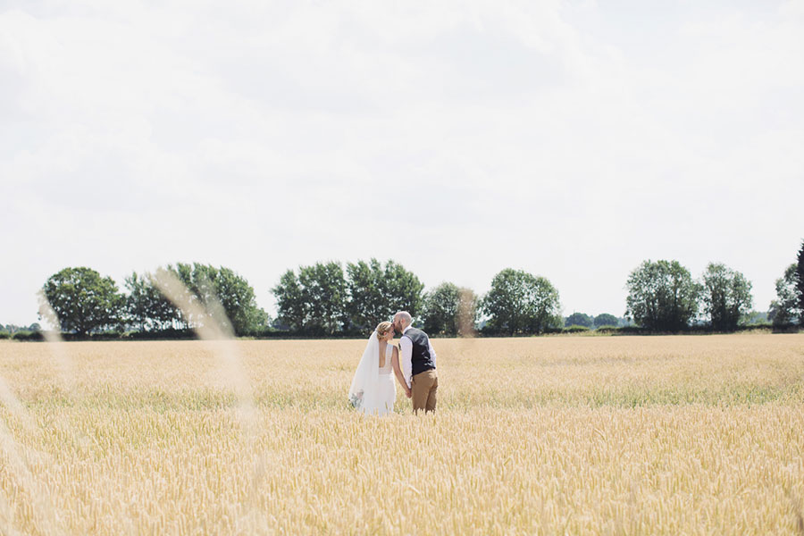 A beautiful English summer day York wedding at barn rustic venue Deighton Lodge with beautiful natural wedding photography of a cornfield pastel bride and groom shoot by Sasha Lee Photography