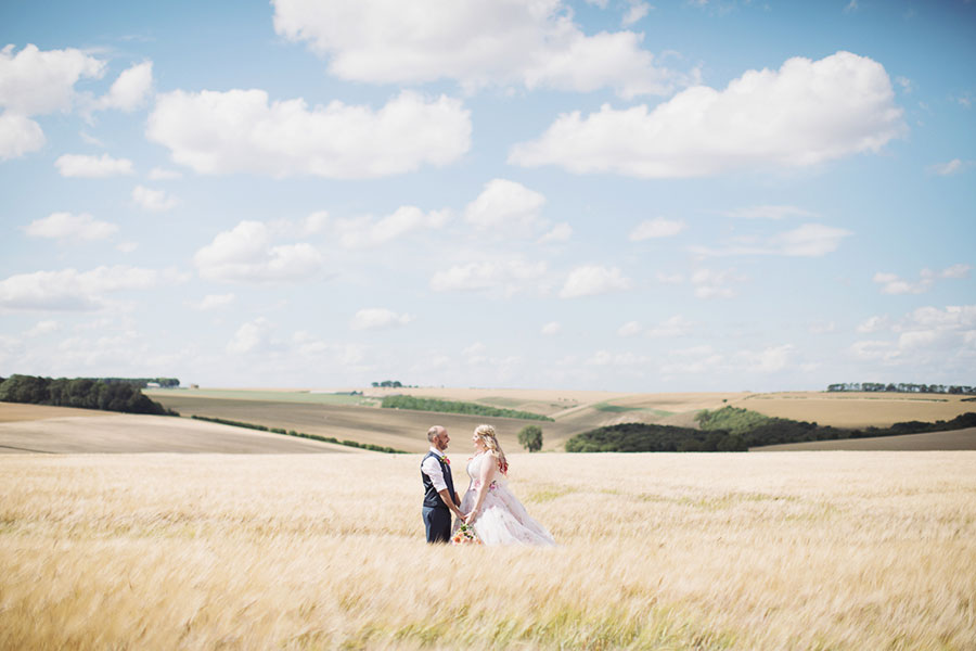 Alternative Yorkshire wedding venue | Driffield natural wedding photography at unique field festival venue Wold Top Brewery with a photo of the bride and groom shoot in a corn field by Sasha Lee Photography