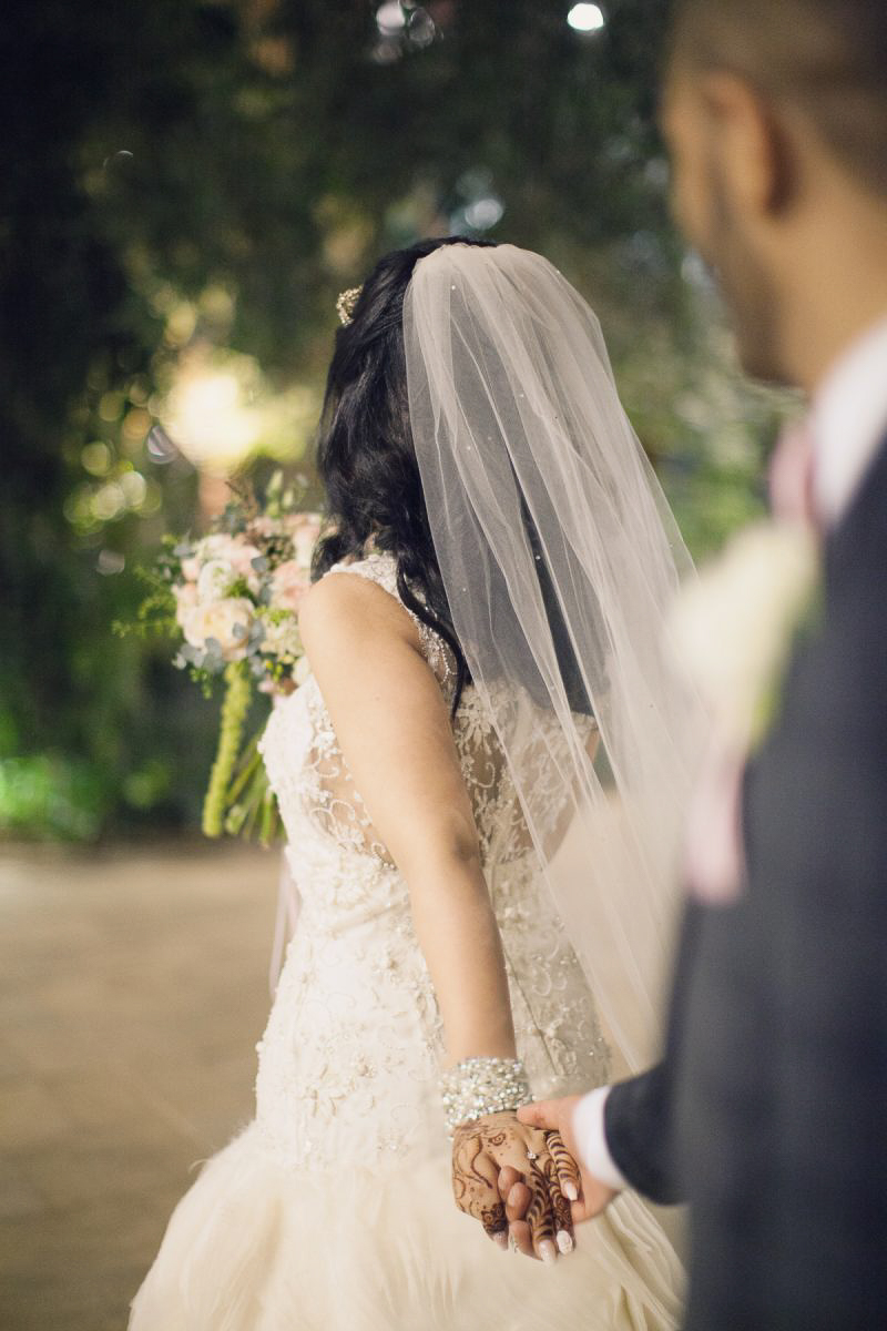 Muslim Bride with a white wedding dress