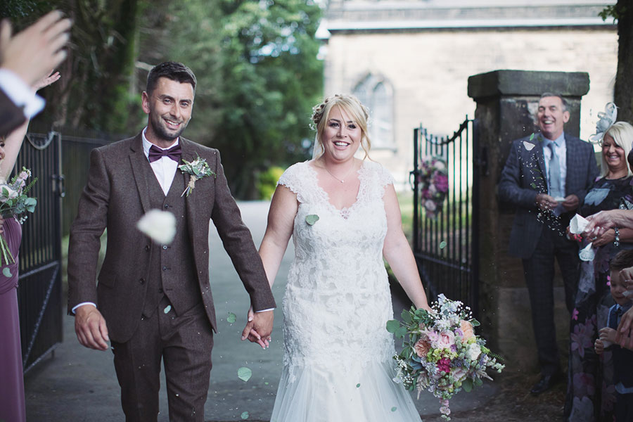 South Yorkshire Sheffield Rotherham natural wedding photography at St James Church a cute small intimate church wedding with a photo of confetti throw by Sasha Lee Photography