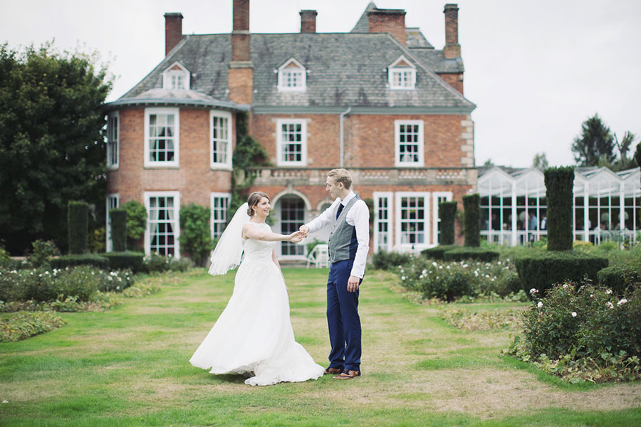 Yorkshire Leicestershire Loughborough wedding venue at Sutton Bonington Hall manor house with natural wedding photography of the husband and wife dancing outside