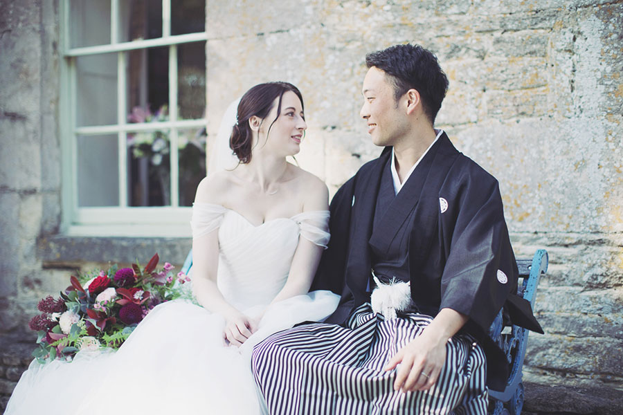 Beautiful rustic Tetbury wedding venue at The Great Tythe Barn with a Japanese English traditional wedding blend asian custom with natural wedding photography of the bride and groom shoot