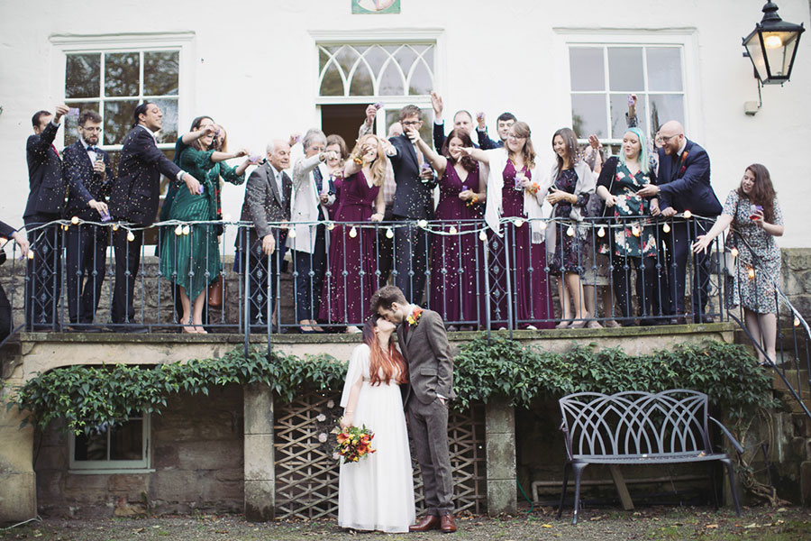 The Old Deanery Ripon wedding venue natural photography with beautiful Autumn weather and a photo of the confetti throw