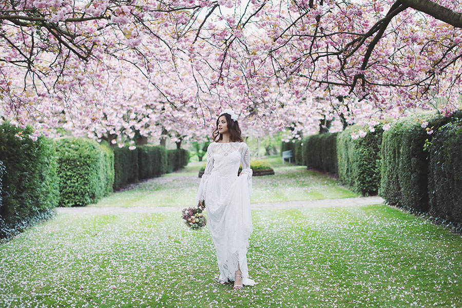 Cherry Blossom wedding | Wedding under cherry blossom | Beautiful spring wedding | Asian bride with romantic hair & makeup | Lace wedding dress | Bridal hair accessories at Hazlewood Castle