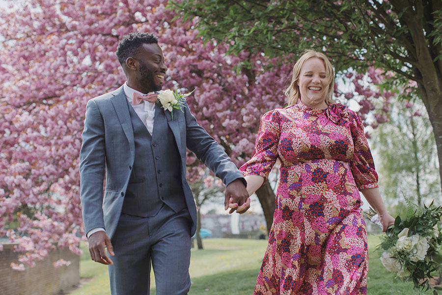 Mansfield Registry Office wedding | Nottinghamshire wedding photography natural | Alternative pink bridal dress | Interracial couple